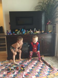 boys playing with toys instead of watching tv